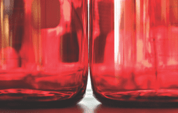 Two containers of red liquid