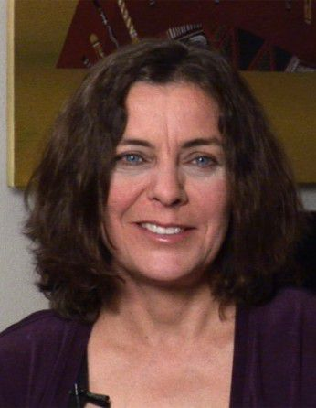 Headshot of Jill Banfield in a purple shirt