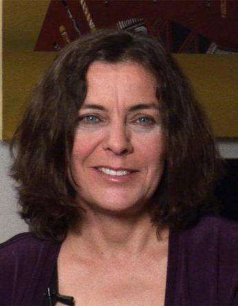 Headshot of Jill Banfield in a purple shirt