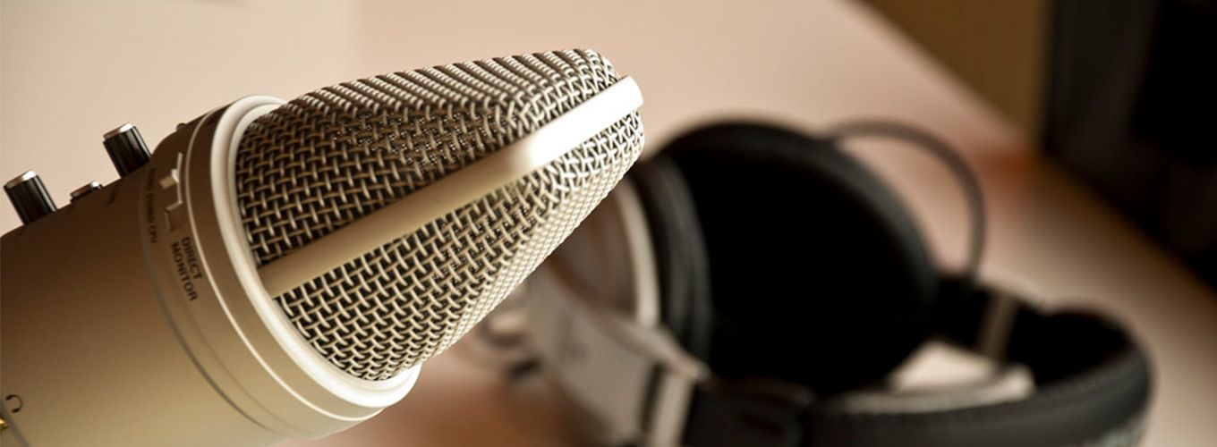 A microphone and headphones set up to record a podcast