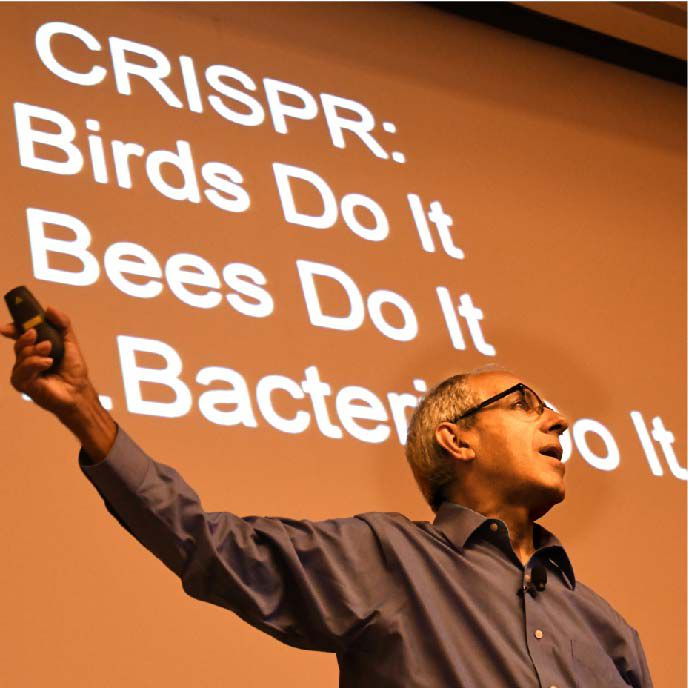 Greg Simon in front of powerpoint slide at CRISPRcon
