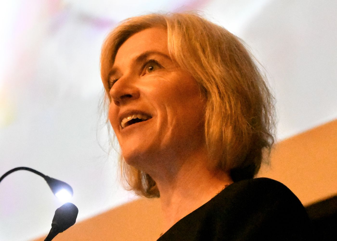 Jennifer Doudna speaking on stage at CRISPRcon