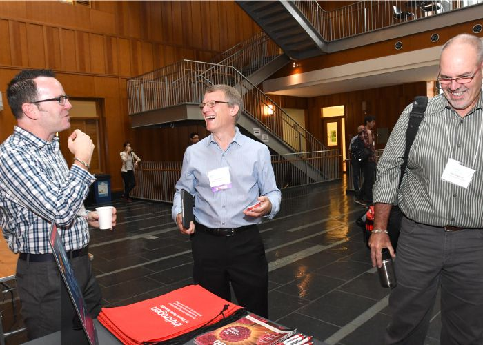 Three professors laughing at the the Rewriting Genomes Symposium