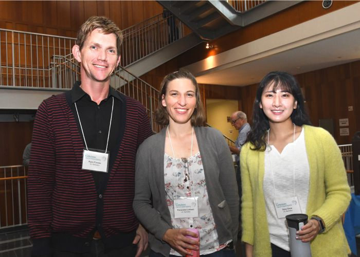 Three students at the the Rewriting Genomes Symposium