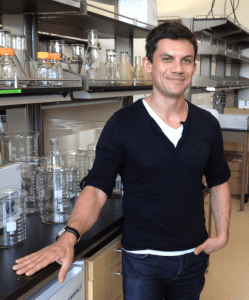 Professor Roberto Zoncu standing by a lab bench