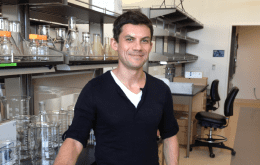 Roberto Zoncu standing near lab bench