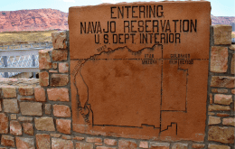 Sign at the entrance of the Navajo Nation with a map of the reservation location