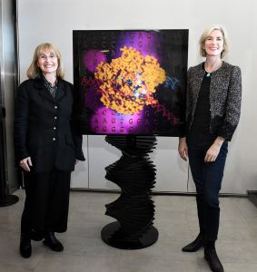 Ellen Sandor and Jennifer Doudna standing in front of a Cas9 art installation