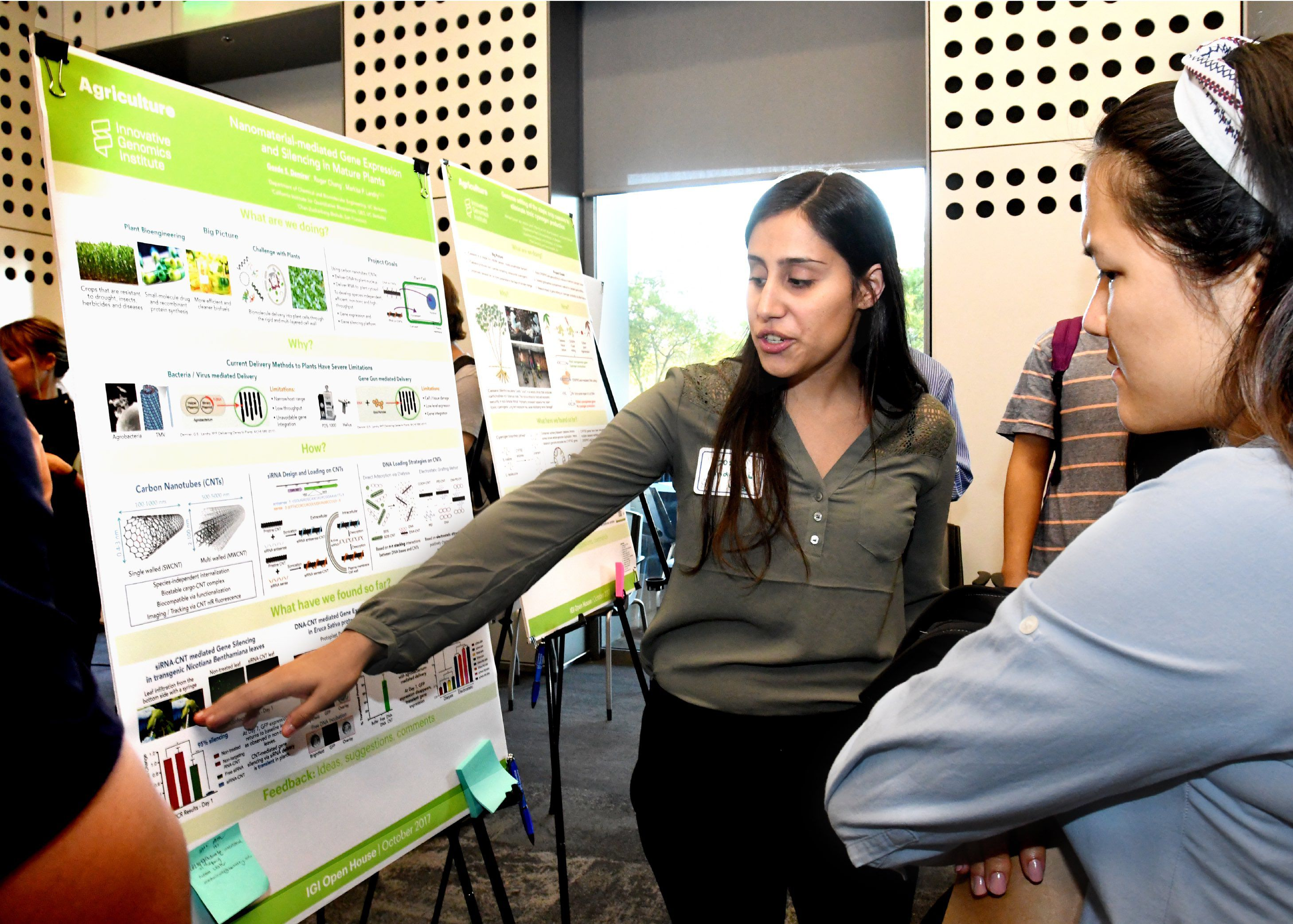Gözde Demirer presenting a scientific poster