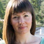 Headshot of professor Kim Seed