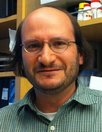 A headshot of professor Michael Bassik