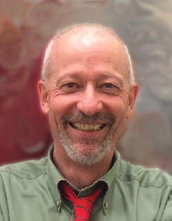 a headshot of professor Luca Comai