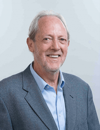 Headshot of professor Ken Taymor