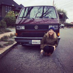 Dana Foss in front of a van