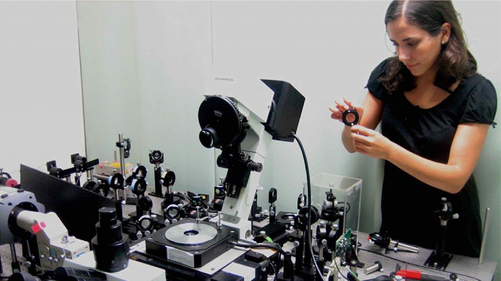 Professor Markita Landry in front of a microscope