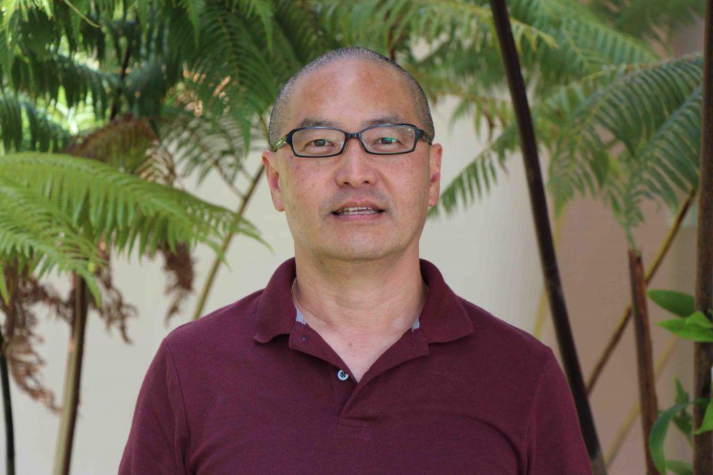 Headshot of John Suzuki