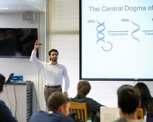 Scientist Michael Gomez giving a presentation in a classroom