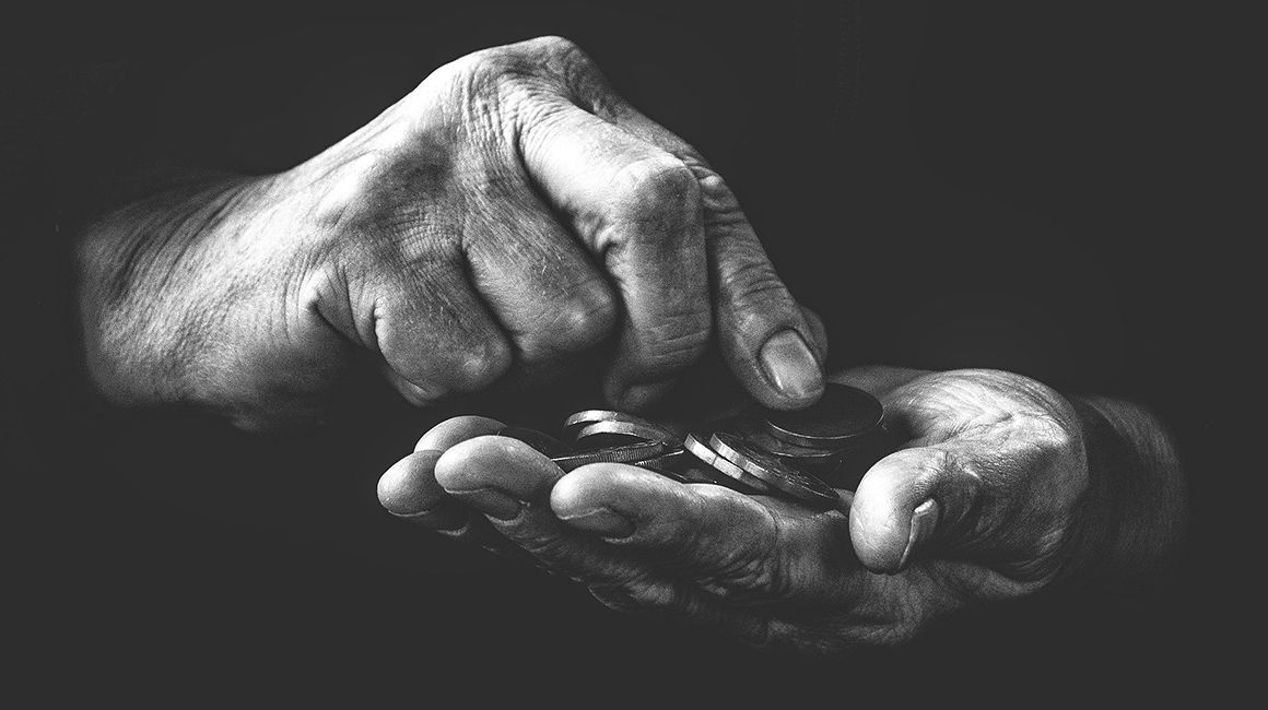 photo of hands holding coins