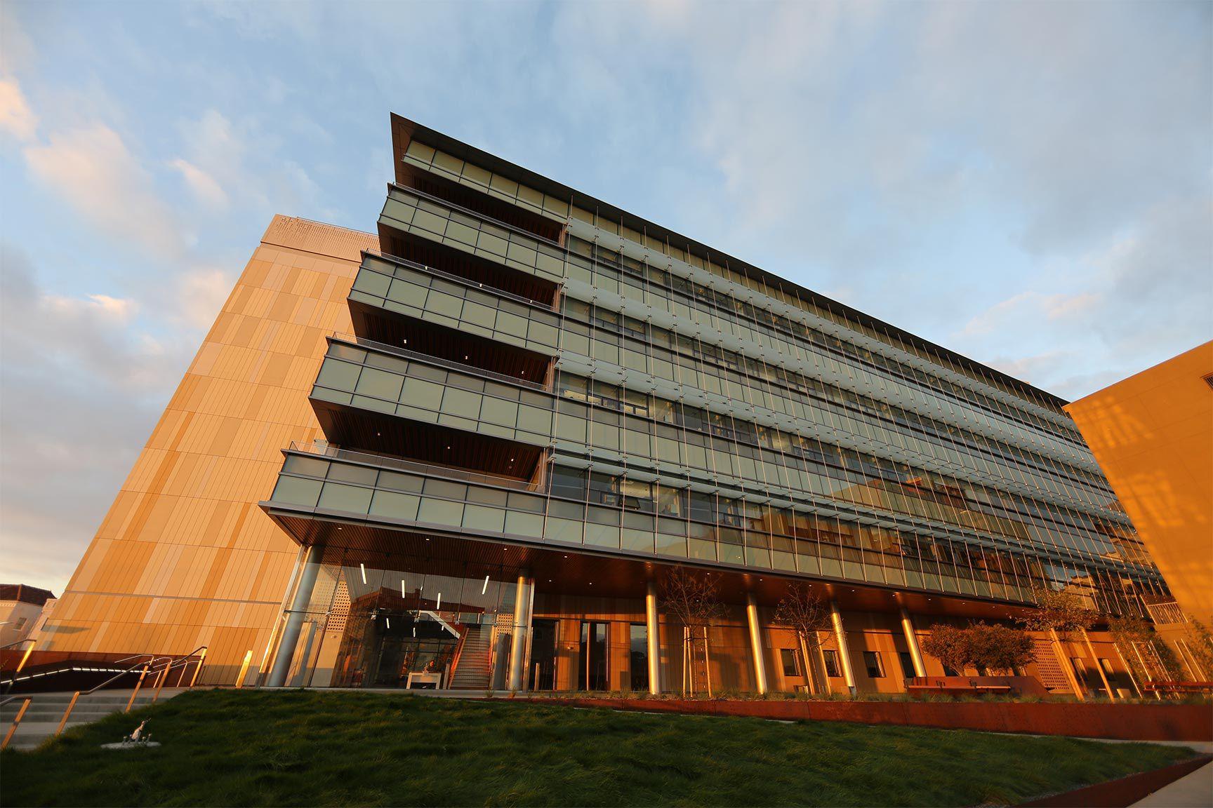 Wide shot of IGI building at sunset