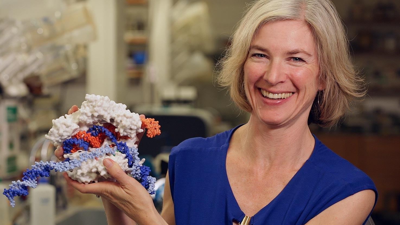 Jennifer Doudna posing with CRISPR model