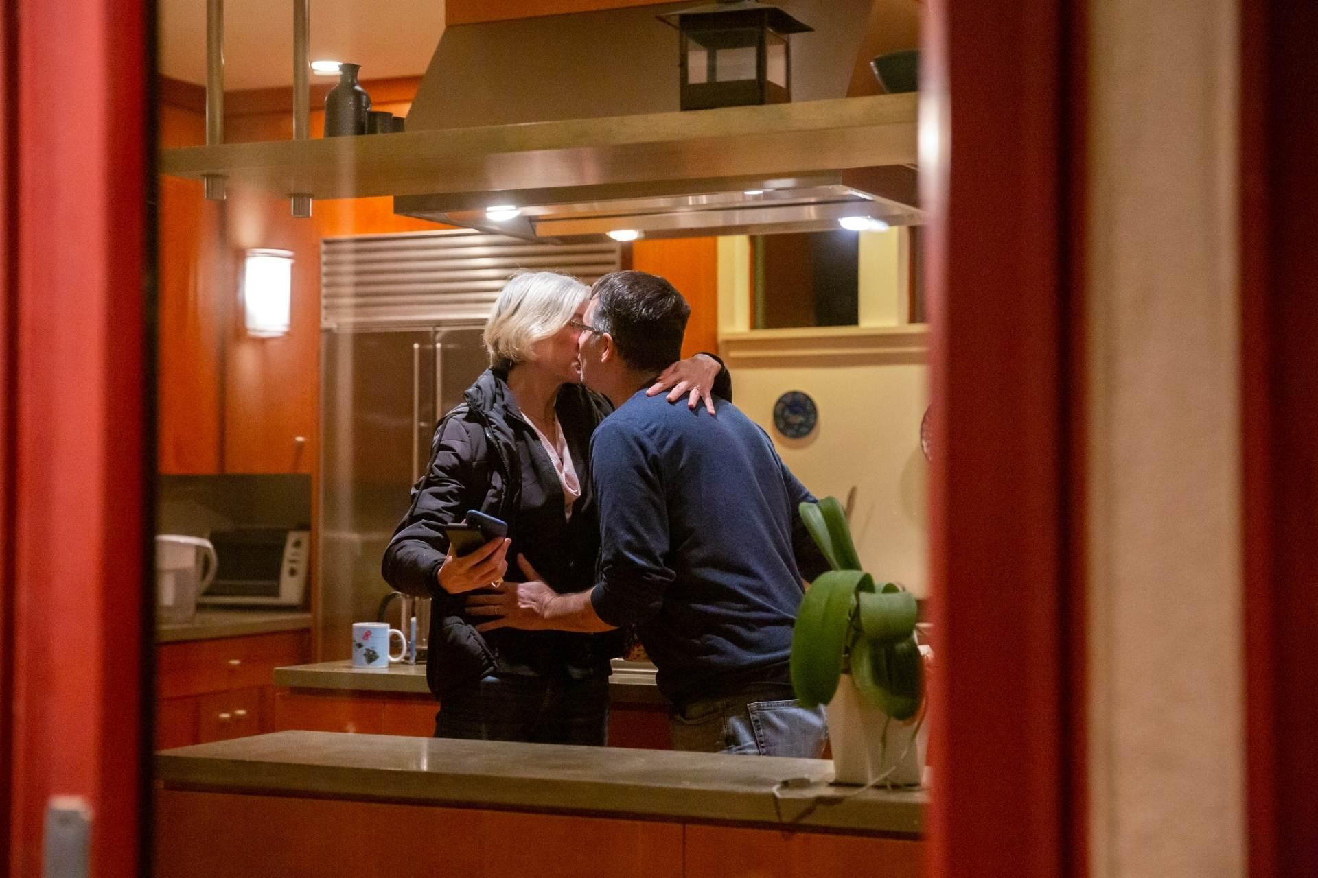 Jennifer Doudna kissing husband Jamie Cate after winning the Nobel Prize