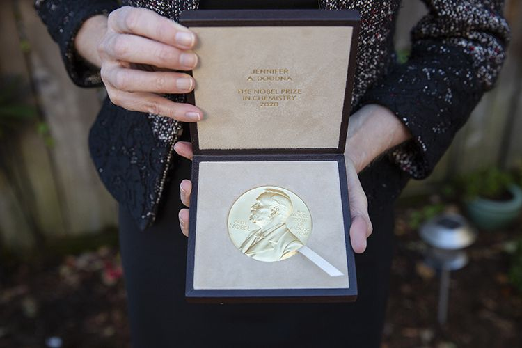 Closeup of Jennifer Doudna displaying the Nobel Prize medal in its case