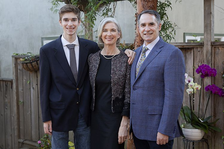 Jennifer Douda with her husband and son