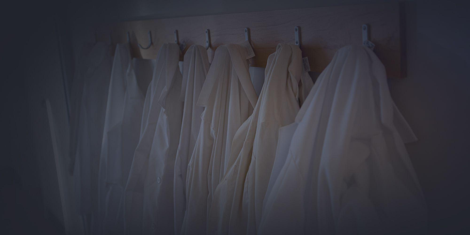 Photo of hanging lab coats