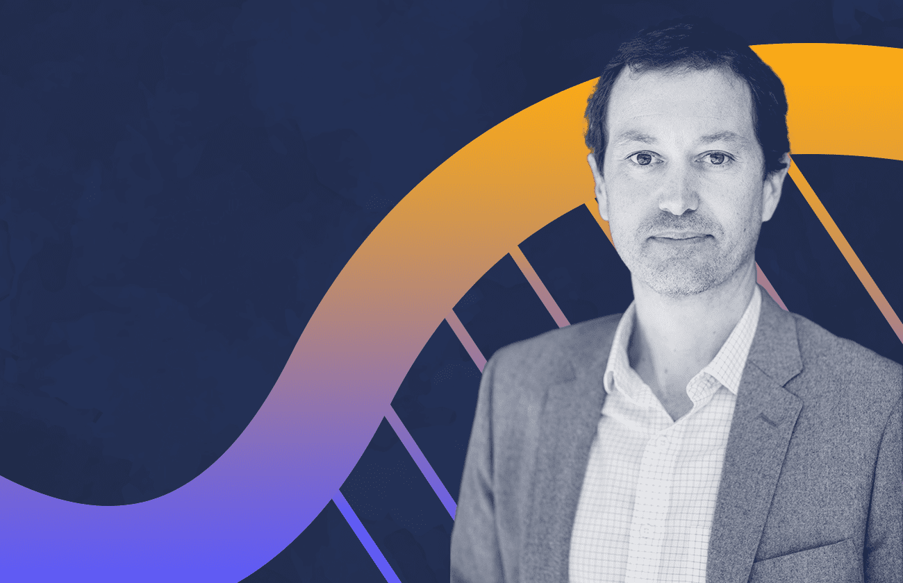 Photo of Dave Savage over an illustrated DNA background